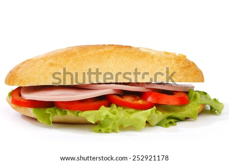 Closeup of sandwich with ham and fresh vegetables - stock photo