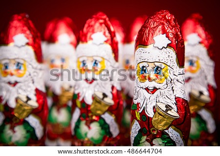 Closeup of Santa Claus chocolate figurine on red background