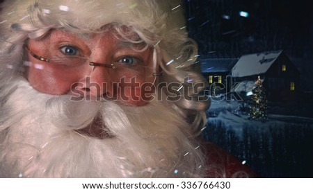 Closeup of Santa Claus with night time scene in background - stock photo