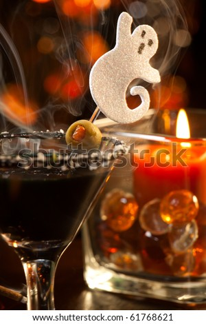 Closeup of Scary Martini, black vodka, vermouth, garnished with olive - Halloween drinks series - stock photo