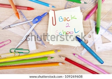 Closeup of school equipment with text of back to school on the notice - stock photo