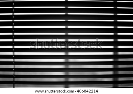 Closeup of semi open blinds in black and white. - stock photo