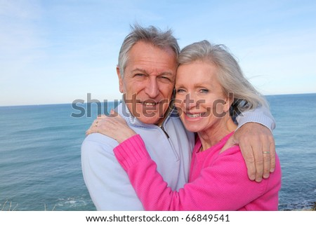 Closeup of senior couple by the sea - stock photo