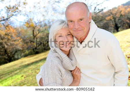 Closeup of senior couple in countryside - stock photo