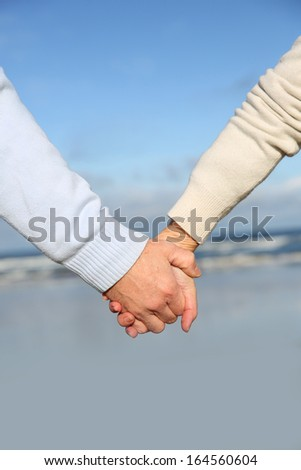 Closeup of senior people holding hands