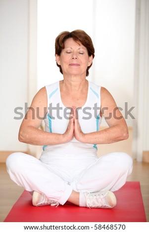 Closeup of senior woman doing relaxation exercises - stock photo