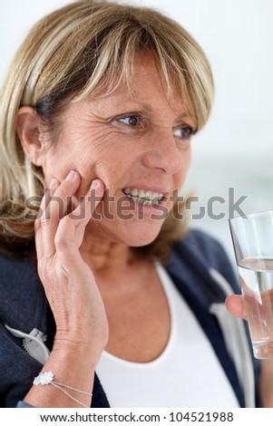 Closeup of senior woman having toothache - stock photo
