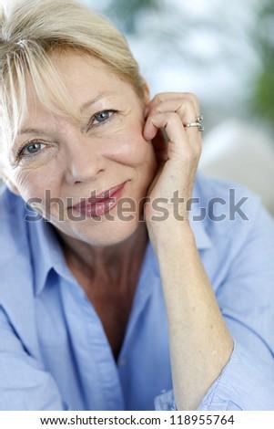 Closeup of senior woman with blue shirt - stock photo