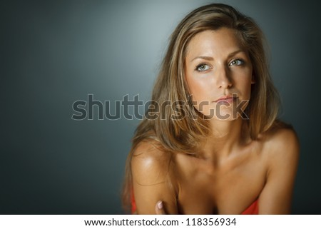 Closeup of sensual beautiful woman over dark background looking to the blank copy space - stock photo