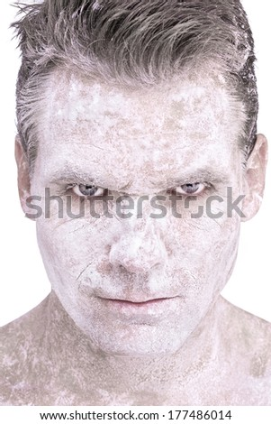 Closeup of serious Caucasian man with white flour powdered over entire face and neck on white background - stock photo