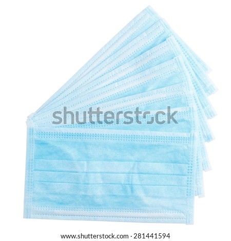 Closeup of several medical protective masks isolated on white background  - stock photo