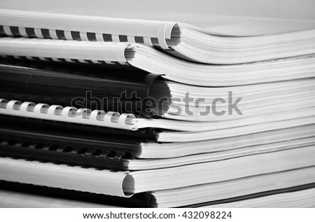Closeup of several printed books in black and white colors - stock photo