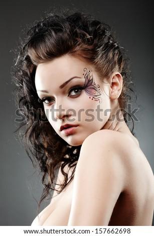 Closeup of sexy young woman wearing fantasy makeup - stock photo