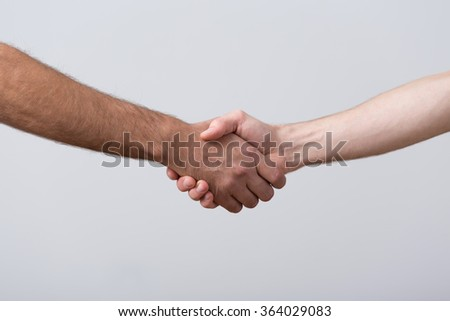 Closeup of shaking hands on bright background