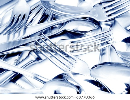 Closeup of shiny spoon, knife and fork - stock photo