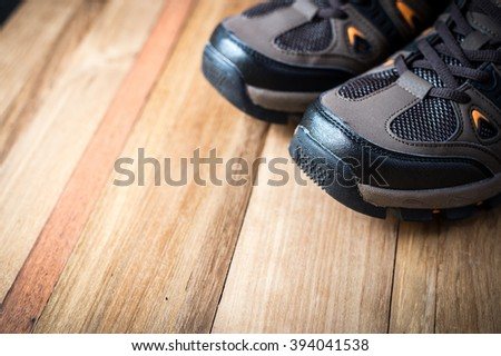 closeup of shoes on wooden background
