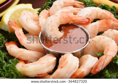 Closeup of shrimp cocktail with lemon wedges and garnish - stock photo