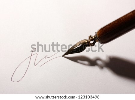 Closeup of signature (fake, not real) and ink pen, isolated on white - stock photo