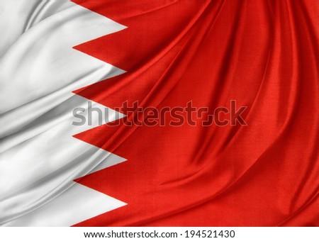 Closeup of silky Bahrain flag - stock photo