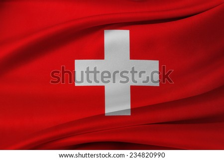Closeup of silky Swiss flag  - stock photo
