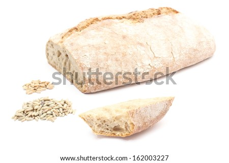 Closeup of slice of rye bread, loaf bread and heap of rye and wheat grain. Isolated on white background