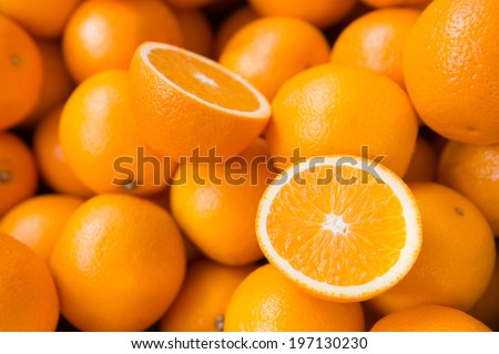 Closeup of sliced oranges on a market - stock photo