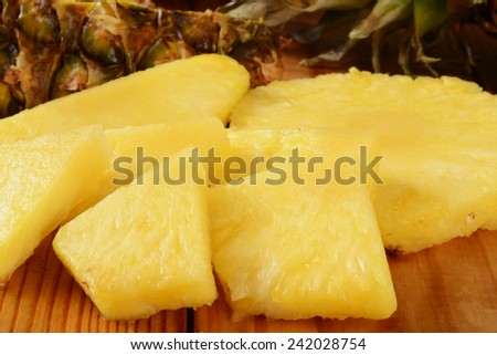 Closeup of sliced pineapple on a cutting board