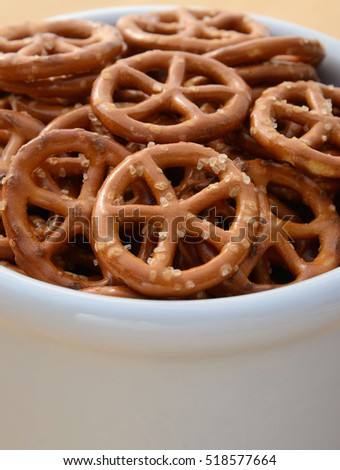 Closeup of small round pretzels in a white bowl