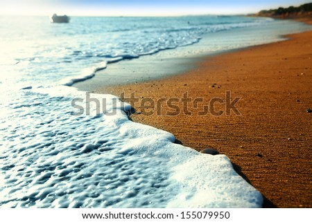 Closeup of small waves on the beach