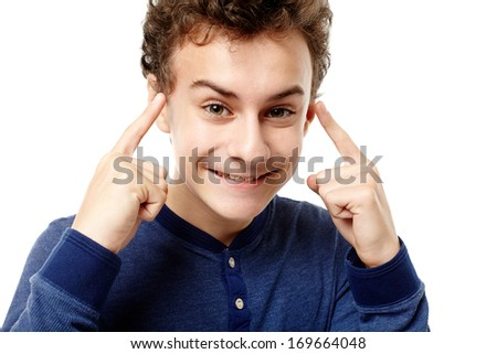 Closeup of smart teenager pointing his head with fingers having a brilliant idea, isolated over white background - stock photo
