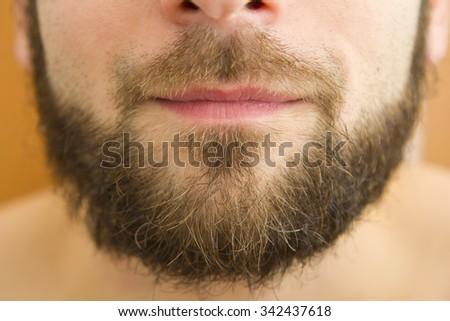 Closeup of smiling beard man. fashion concept