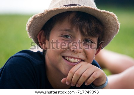 closeup of smiling boy with a hat and holiday