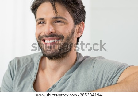 Closeup of smiling man looking away