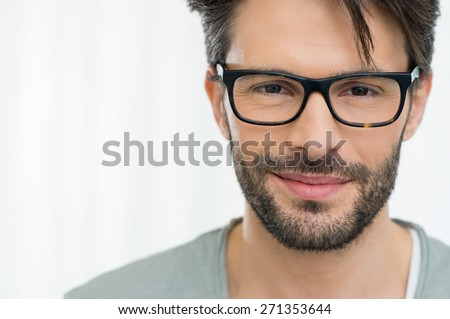 Closeup of smiling man wearing eyeglass - stock photo