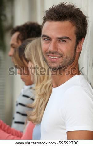 Closeup of smiling student - stock photo