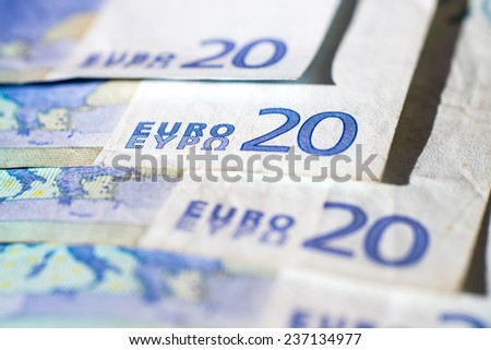 closeup of some banknotes of twenty euro