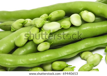 closeup of some broad bean pods and beans - stock photo