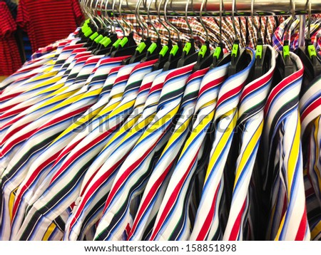 closeup of some clothes hanging on a rail - stock photo