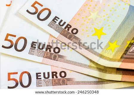 Closeup of some fifty euro banknotes - stock photo