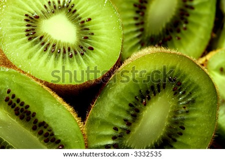 closeup of some kiwi slices - stock photo