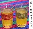 closeup of some ornamented glasses with tea - stock photo