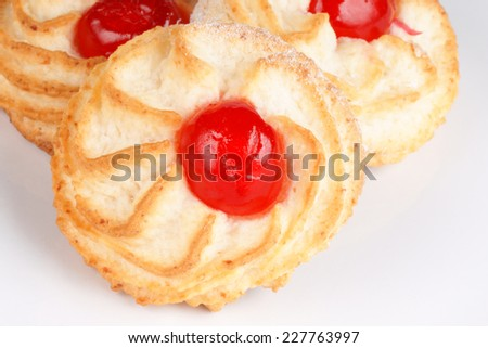 Closeup of some sicilian almond pastries with candied cherries.