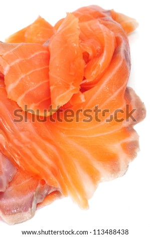 closeup of some slices of smoked salmon on a white background - stock photo