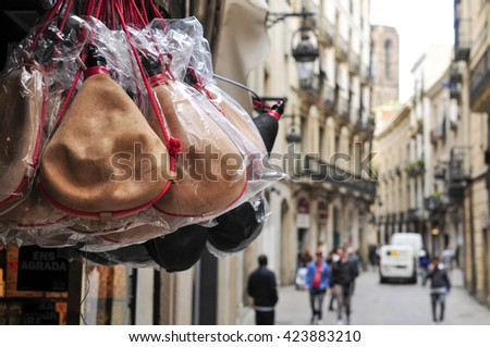 closeup of some typical spanish bota bags on sale in the old town of Barcelona, Spain