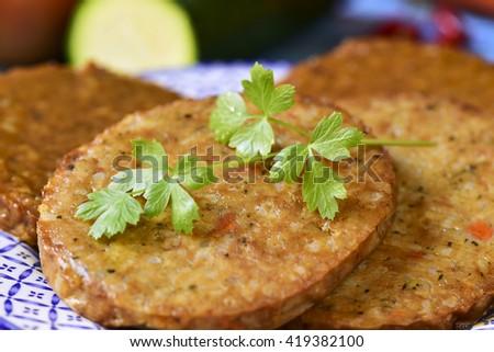closeup of some veggie burgers in a ceramic plate - stock photo