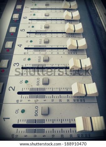 closeup of sound mixer board, vintage corlor - stock photo