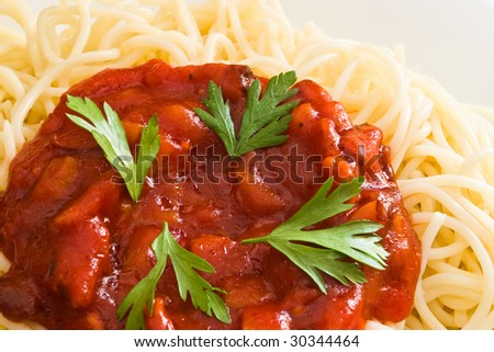 closeup of spaghetti and tomato sauce and parsley