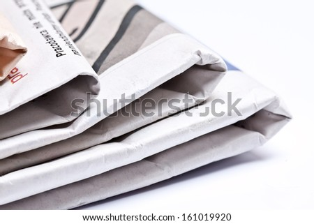 Closeup of stack of newspapers