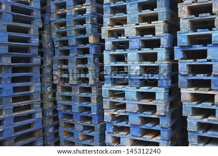 Closeup of stacks of pallets - stock photo