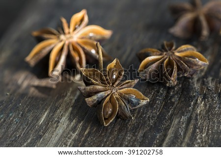 Closeup of star anise on wooden background - stock photo